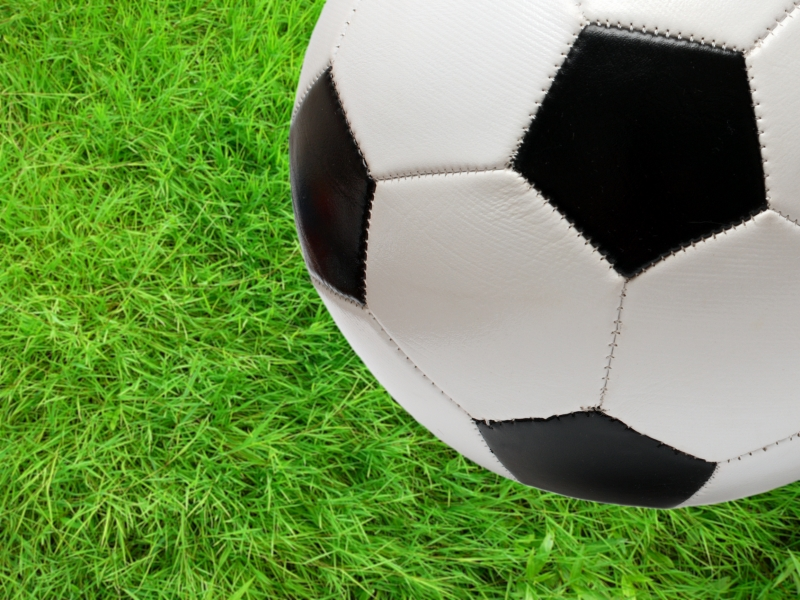 -football-soccer-ball-over-green-grass